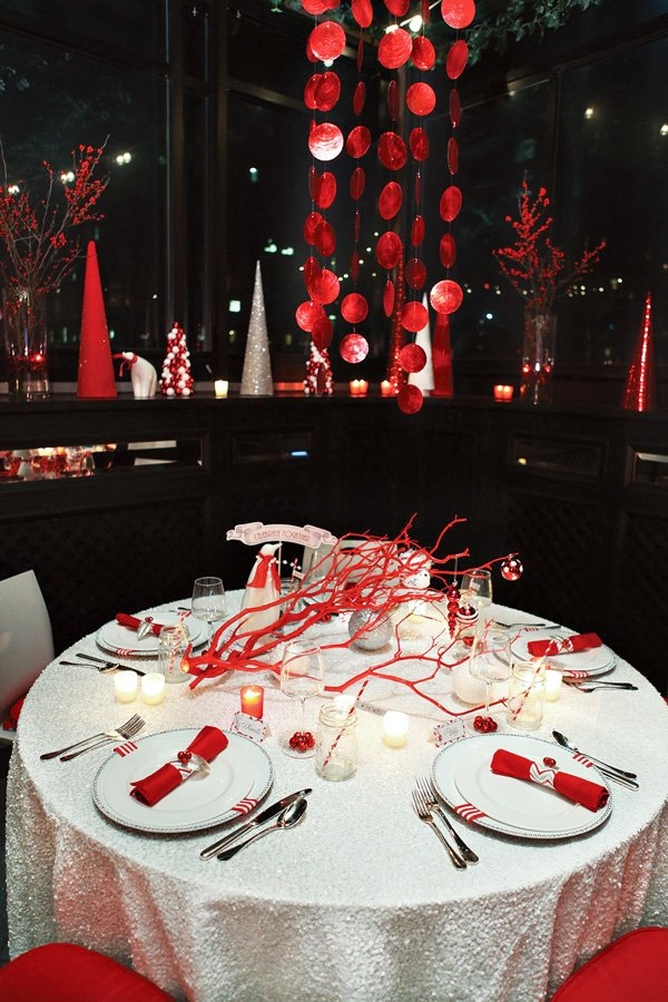 Modern Red and White holiday tablescape with red capiz chandelier and sequin tablecloth