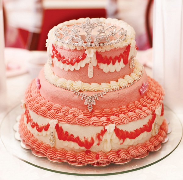 pink princess birthday cake topped with a jeweled crown