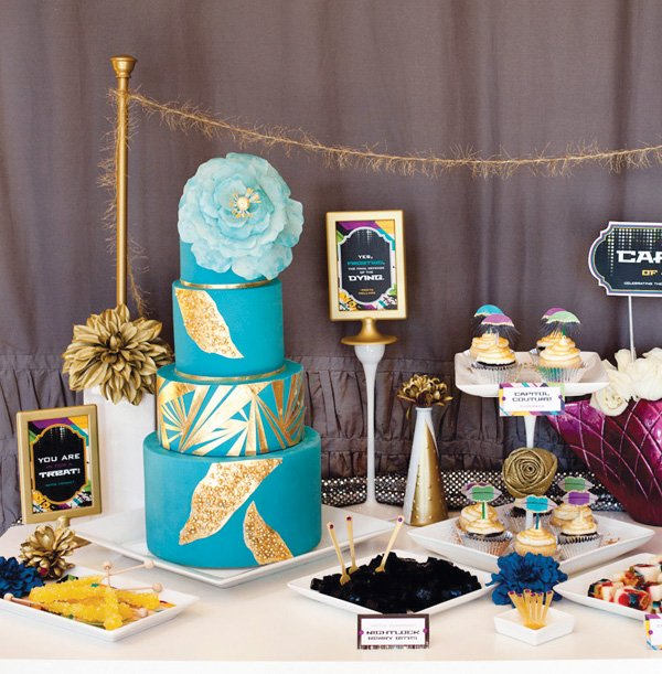 effie trinket blue and gold cake