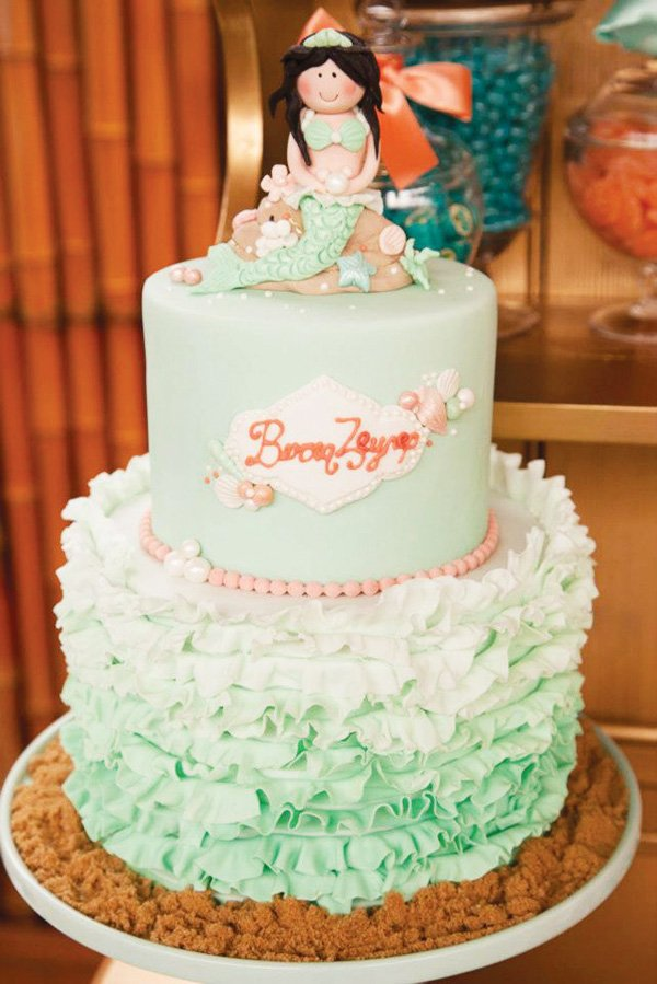 Turquoise ombre ruffle cake with fondant mermaid topper