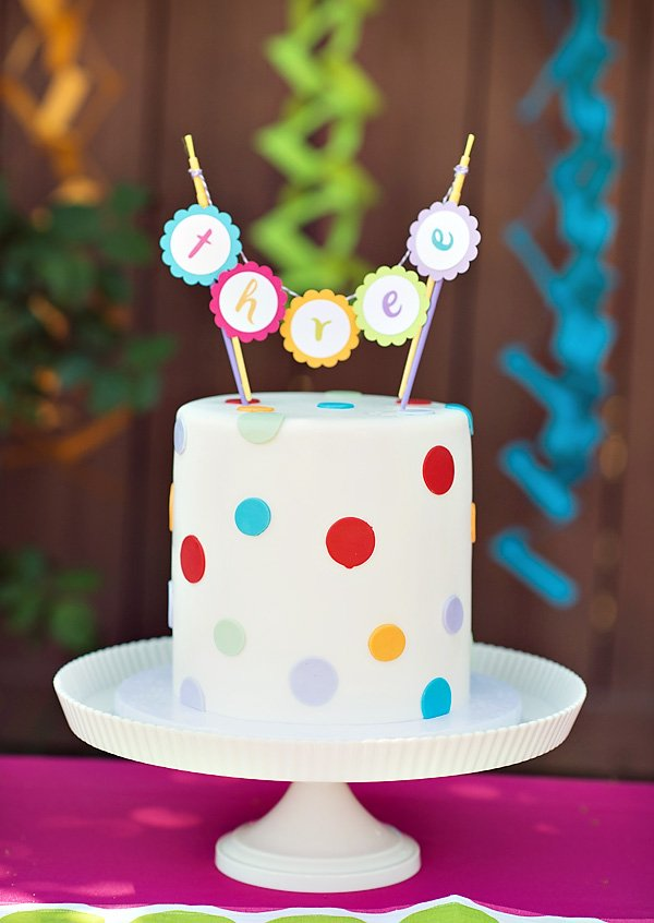 Rainbow polka dot birthday cake with mini scalloped bunting