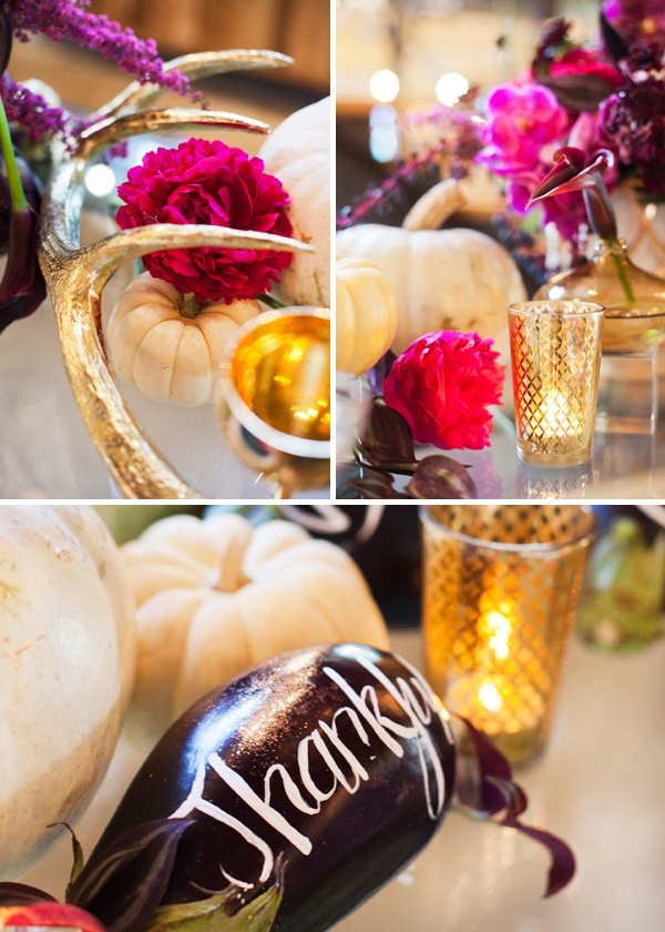 holiday table with gold spray painted antlers, pink and purple flowers, painted eggplants, and gold votive candle holders