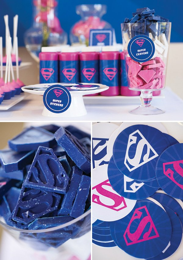 pink and blue party favors like bubbles, crayons and stickers