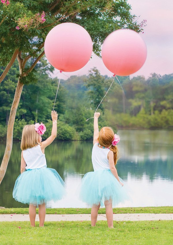 large pink balloons for twins' birthday party