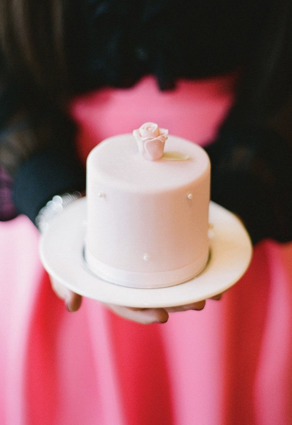 mini rose topped pink and pearl cake