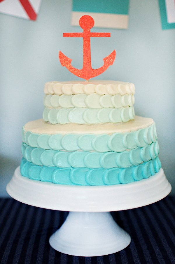 nautical party tier cake with anchor topper