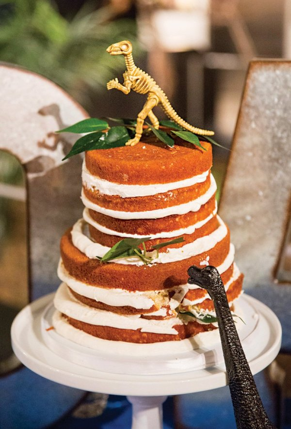 dinosaur topped naked birthday cake