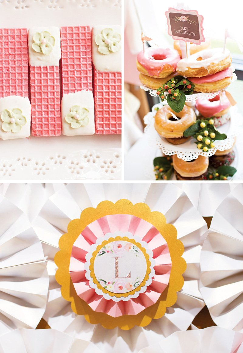 pink and white wedding desserts like a doughnut tower