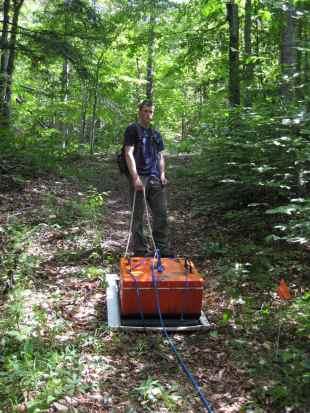 Geoff Schwaner (hydroped technician) dragging the antenna.