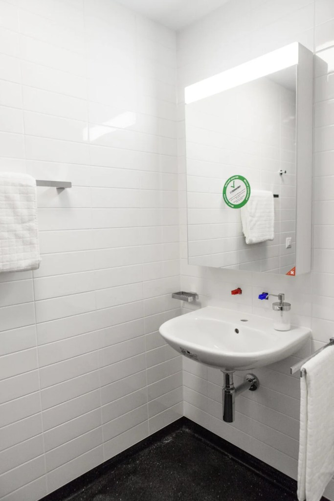 Sink and Mirror in Hospital Cery Bathroom