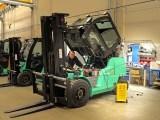 Fuel cell pilot program - Man repairing forklift
