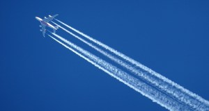 Contrail climate impact - airplane leaving behind contrails