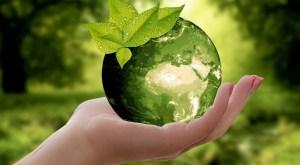 Global hydrogen demand - hand holding green earth
