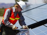 Pennsylvania green energy - person installing solar panels