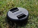 Renewable energy initiative - Sony camera lens cap on grass