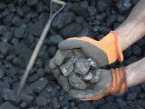Clean hydrogen - hands holding coal