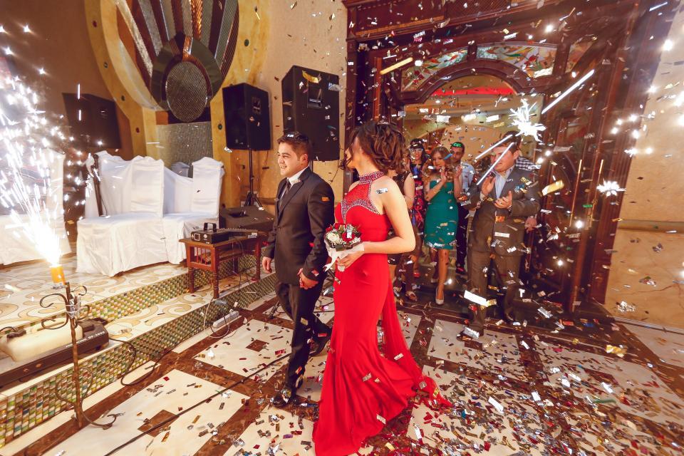 wedding couple walking on the reception area