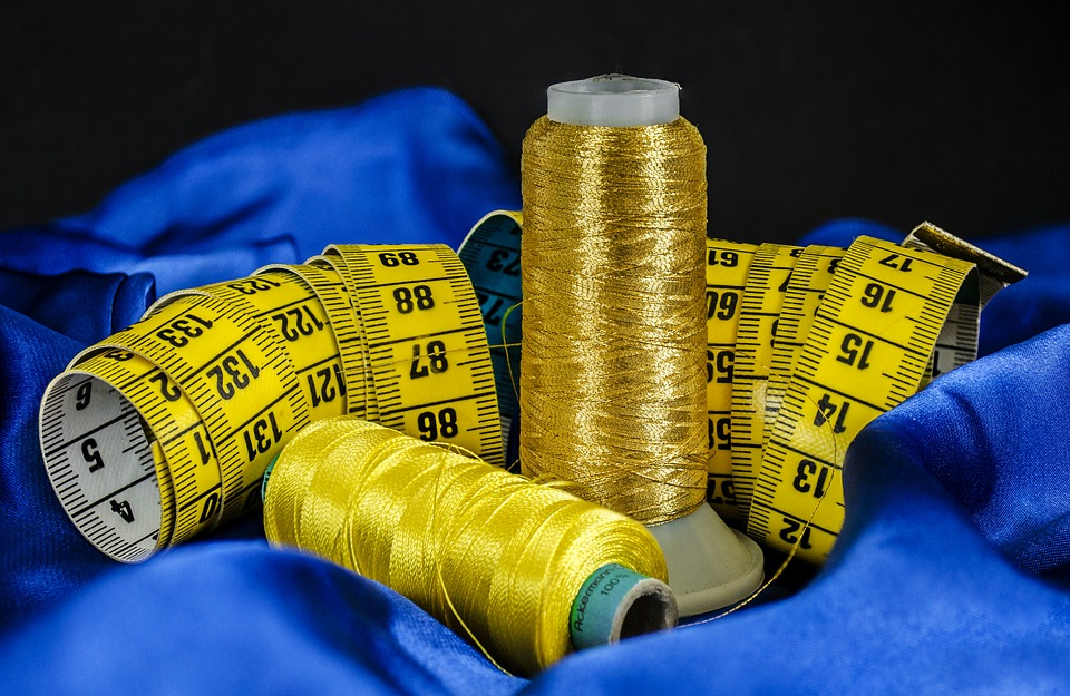 gold and yellow threads with a tape measure