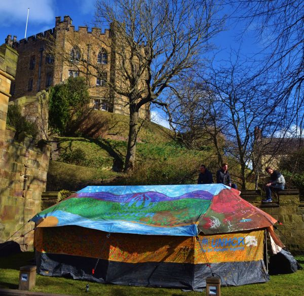 ©Hannah Rose Thomas – One of the tents painted by Syrian refugees is exhibited to the public against the backdrop of Durham Castle, originally built in the 11th Century.