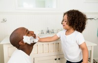 father and child shaving