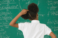 confused girl at chalkboard