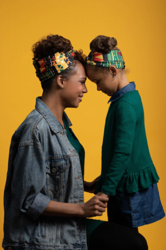 Mother and daughter wearing Cantu Head Wraps.
