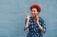 woman with red hair against a blue wall