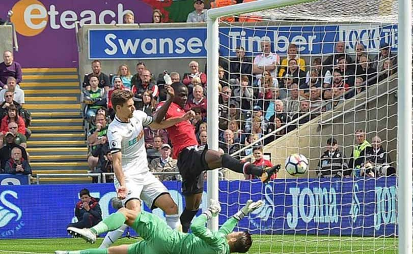 Manchester United slides four past Swansea City in dramatic victory