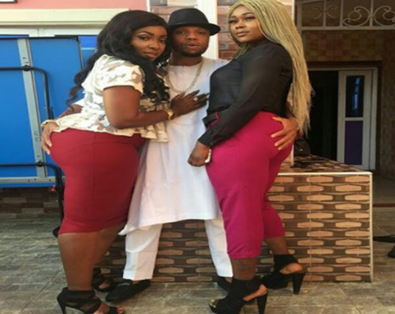 Charles Okocha places his hand on the bum of actresses Anita & Nancy