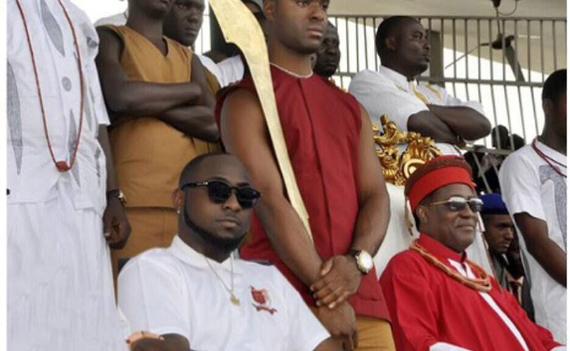 Davido takes a seat by Oba of Benin