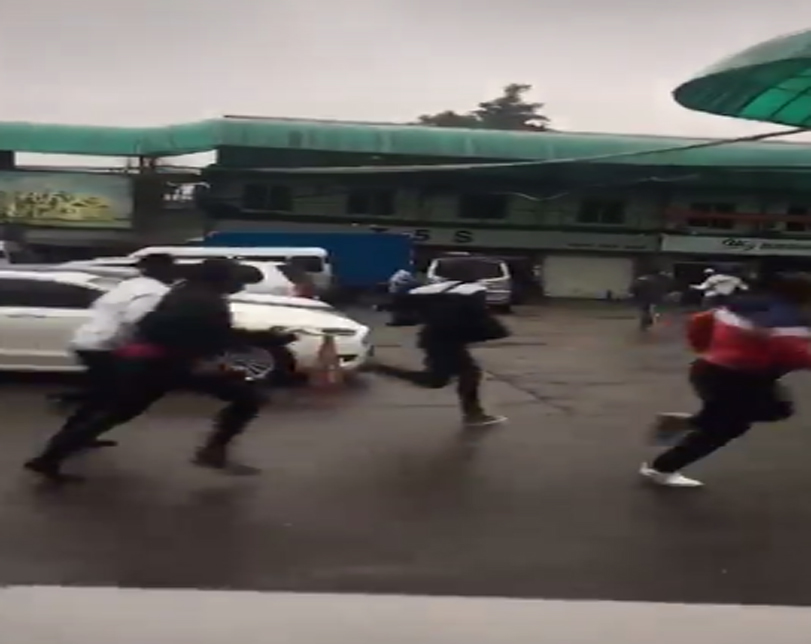 Videos: Nigerians illegally staying in Guangzhou, China, flee as Police raid Market in the Area