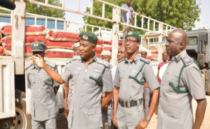 Customs Intercept Two Dangote Trucks Filled With 365 Bags of Foreign Rice