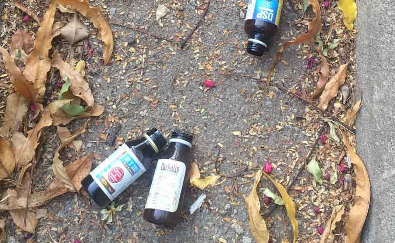 Drug Abuse: Bottles Of Codeine and other substances litter the streets of Abuja