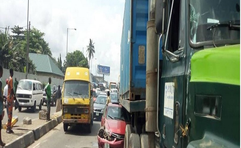PHOTOS: Car runs under trailer in Lagos