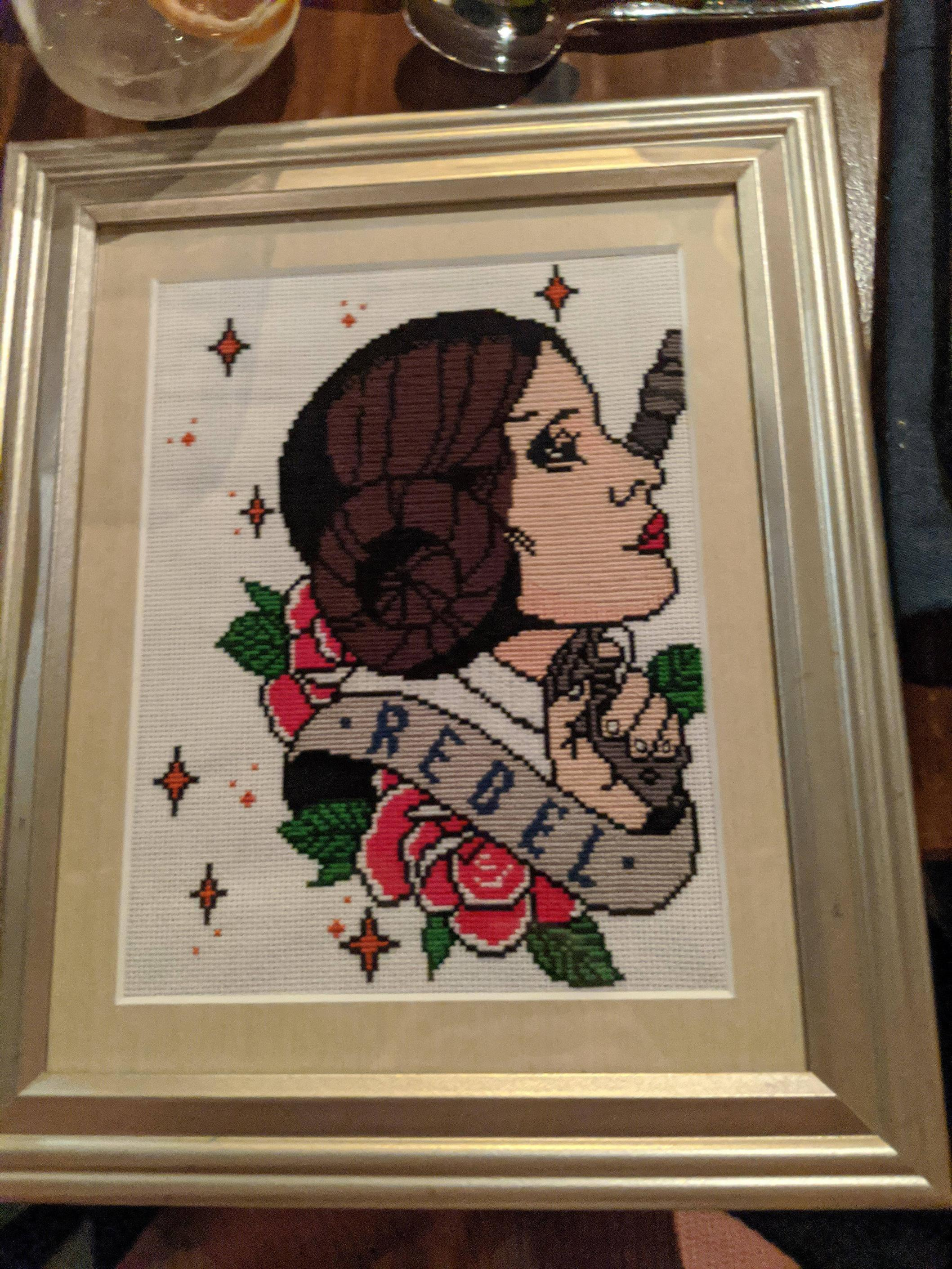 We did a secret santa exchange at work. My coworker free-hand cross stitched this for me and I still can\'t believe it.