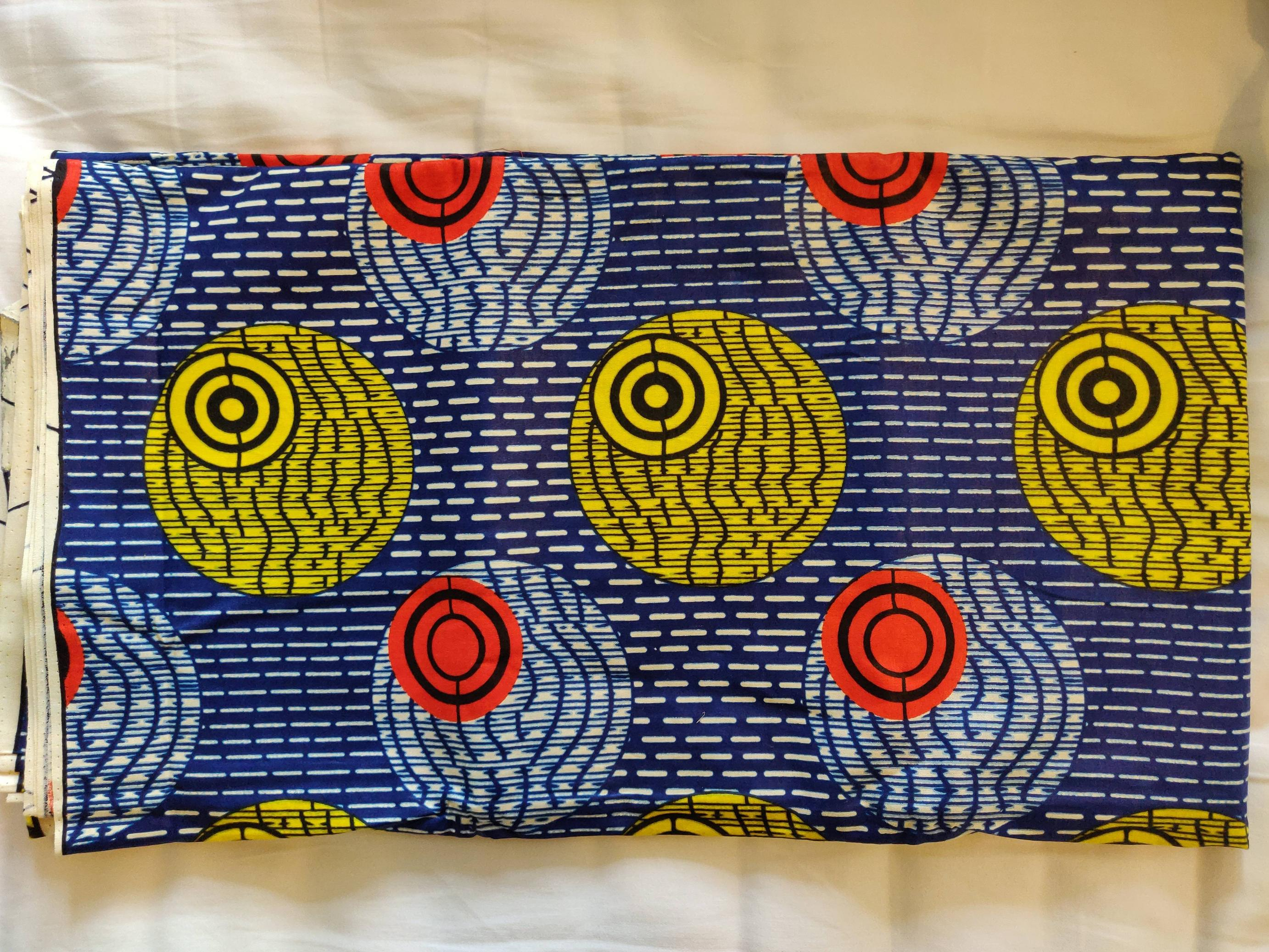 My wife bought some fabric in Sierra Leone. You think the designer was inspired by a small moon?