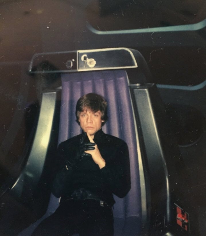 Mark Hamill sitting in the Emperor\'s chair