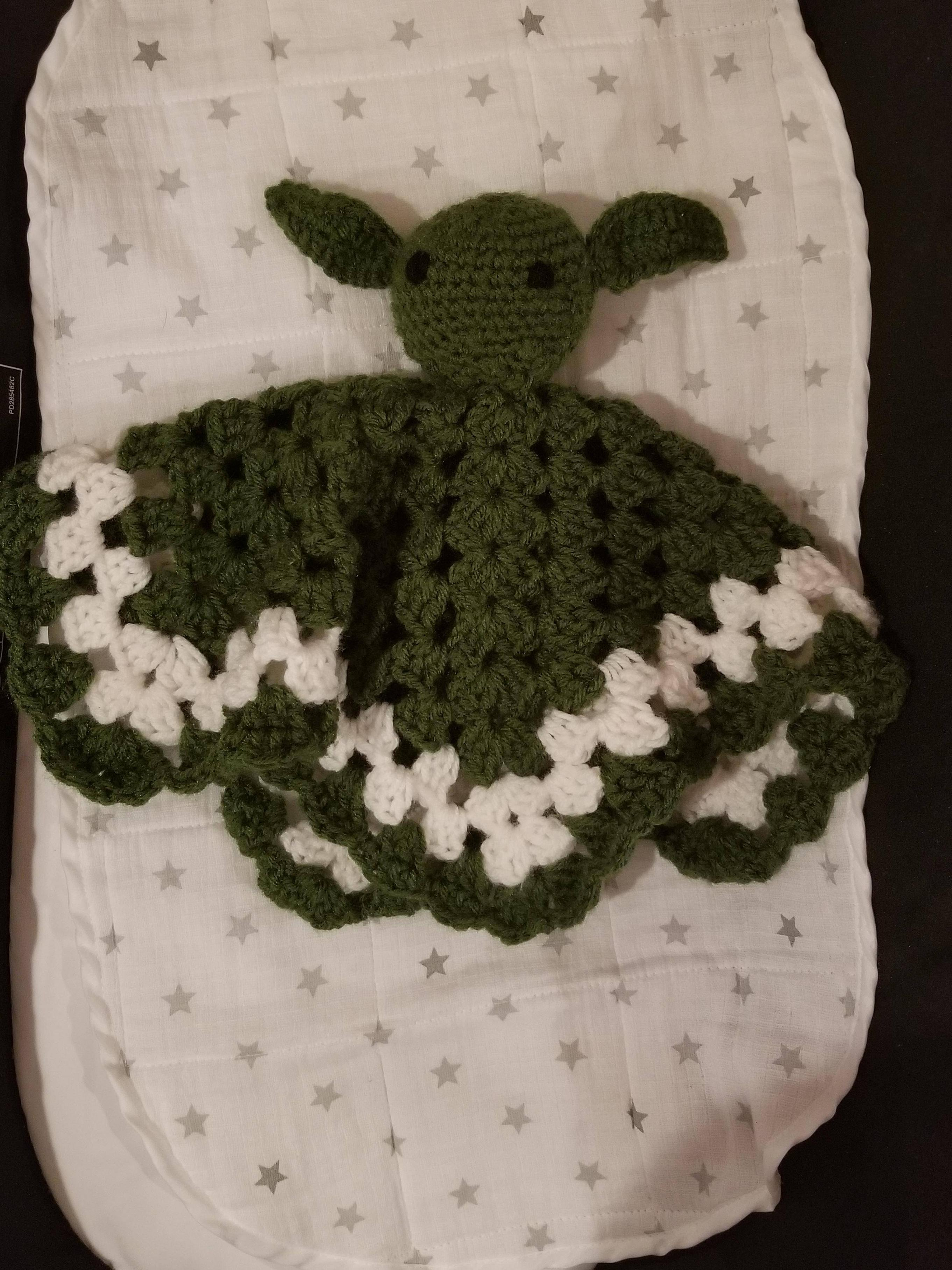 My mother crocheted this Yoda baby blanket for our first child. Thought you guys here would appreciate this.