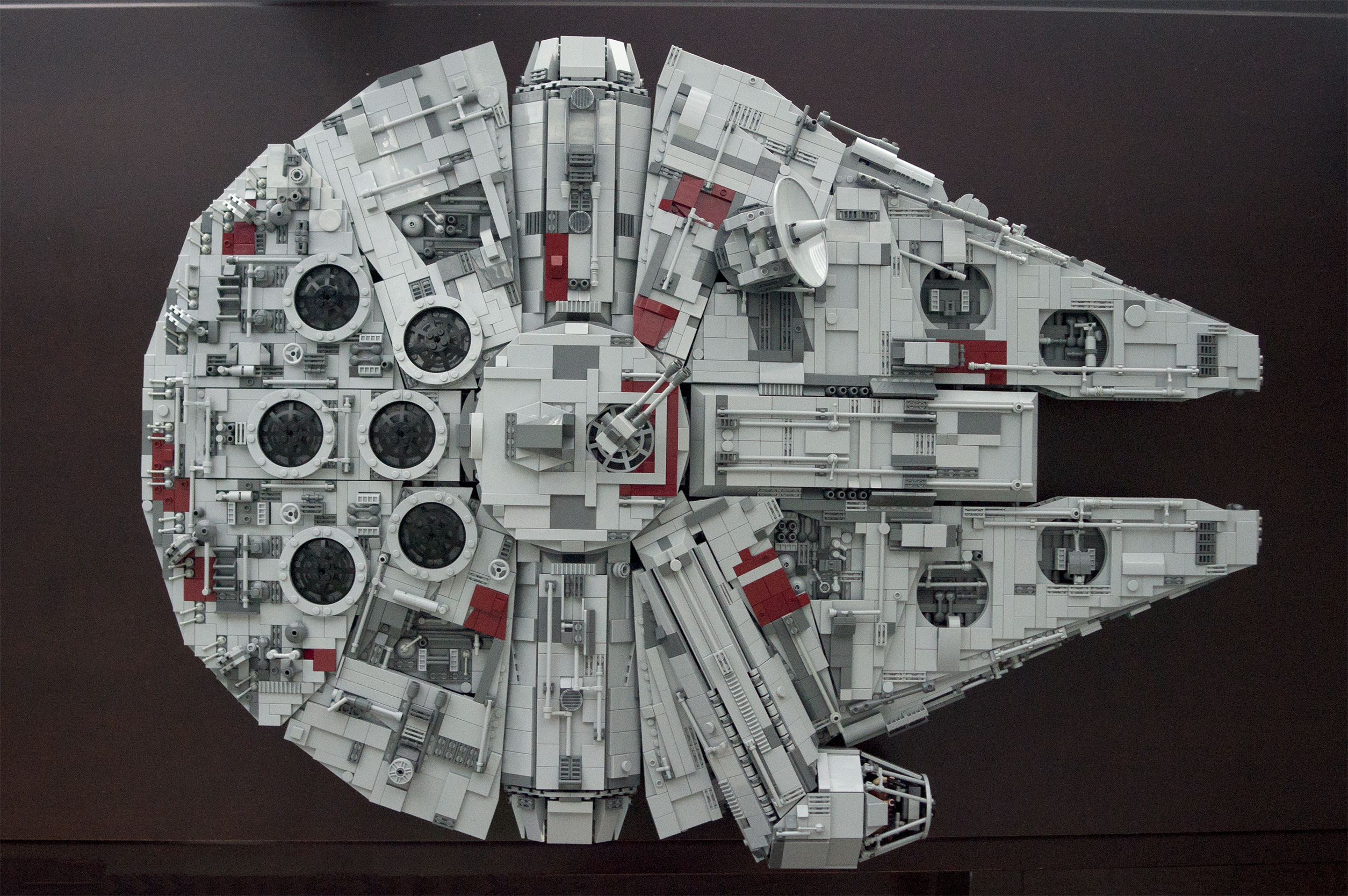 We\'re doing Lego today? Here\'s my heavily modified, almost studless 10179 Falcon. Built from scratch, not a set.