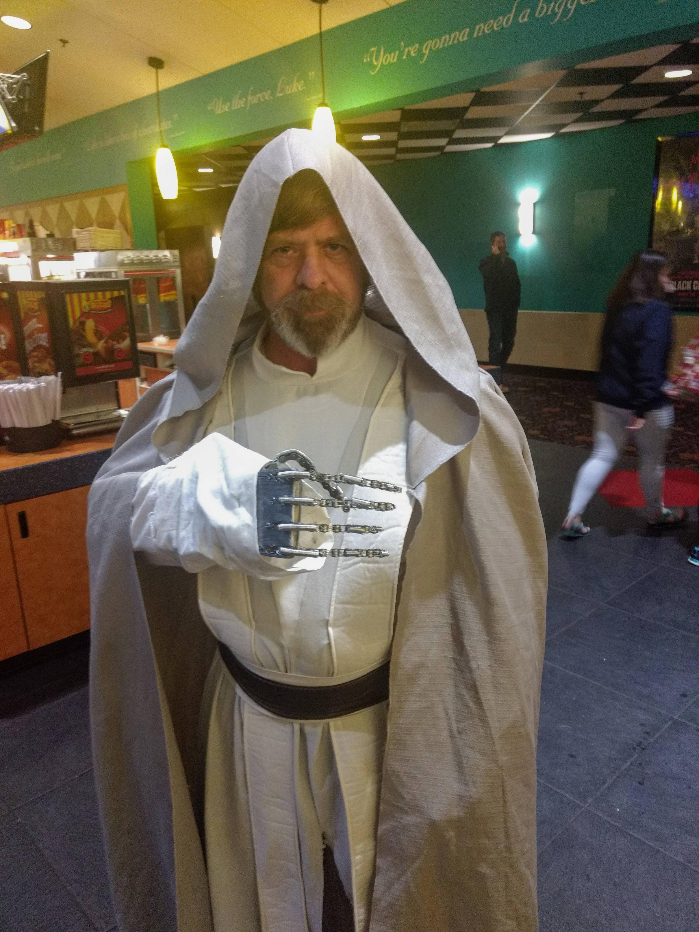 Mark Hamill and my dad look a lot alike. He came in costume to see the movie tonight. This time with a metal hand!