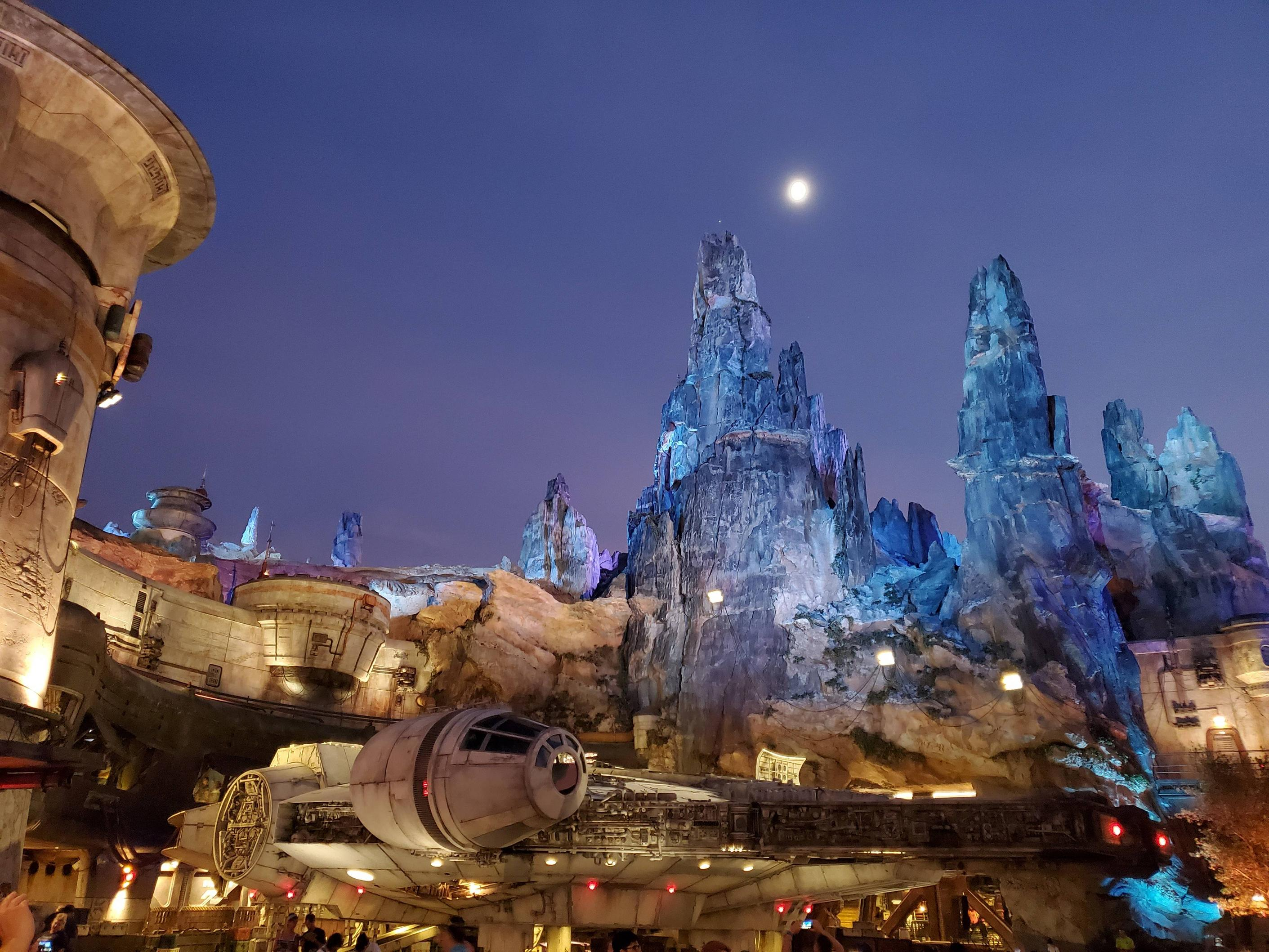 The Millennium Falcon at Galaxy\'s Edge Orlando at night is quite a sight