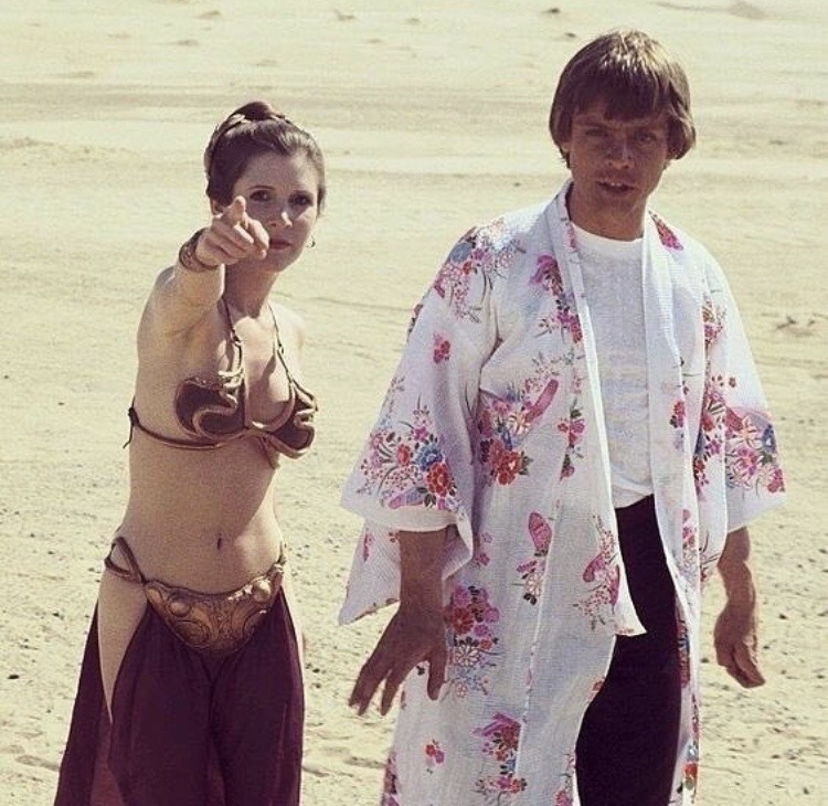 Mark Hamill wearing Carrie Fisher's robe on the desert location of