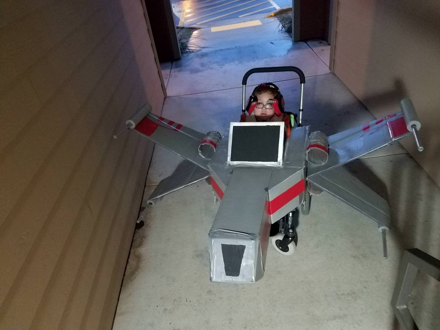 My son didn\'t get to go trick or treating because of the weather but he wanted to show off his X-Wing my wife made for h...