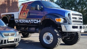 A truck wrapped in the style of Soldier 76 from Overwatch.