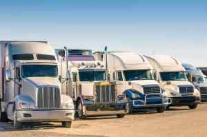 trucks parked on the road
