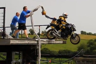 motorcycle does a bungee jump