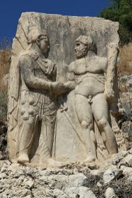 A relief of a Dexiosis between Arsameia, Mithridates or Antiochus I, with Hercules [Wikipedia]