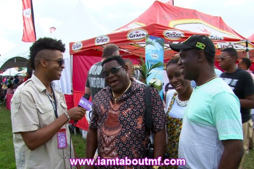 Tabou TMF  talking with event goers at Grace Jamaican Jerk Festival