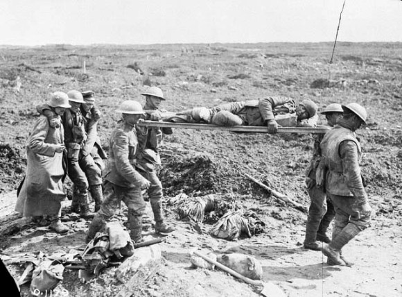 German prisoners follow wounded Canadians to the rear, April 1917