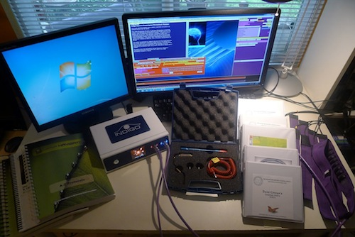 Quantum Biofeedback Indigo with the original Indigo ankle/wrist straps and head harnesses, a Quantum Caress Kit, and valuable training materials